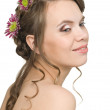 Smiling girl with flowers in their hair — Stock Photo #5747185
