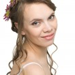 Smiling girl with flowers in their hair — Stock Photo #5747202