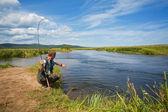 Fisherman catches of salmon — Stock Photo