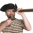 Pirate looks a telescope — Stock Photo