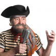 Royalty-Free Stock Photo: Singer dressed as pirate sings  microphone.