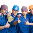 Friendly young team of construction workers — Stock Photo #5776568