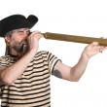 Pirate looks through a telescope — Stock Photo