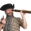 Pirate looks through a telescope - Stock Photo