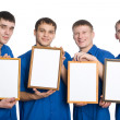 Royalty-Free Stock Photo: Young guys holding the empty frame