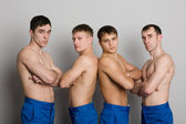 Group of young guys with muscular bodies — Stock Photo