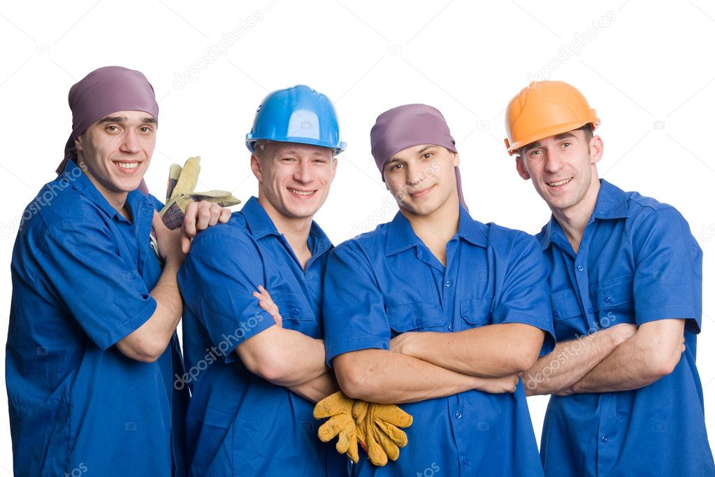 A friendly young team of construction workers. Isolated on white. — Stock Photo #5776565
