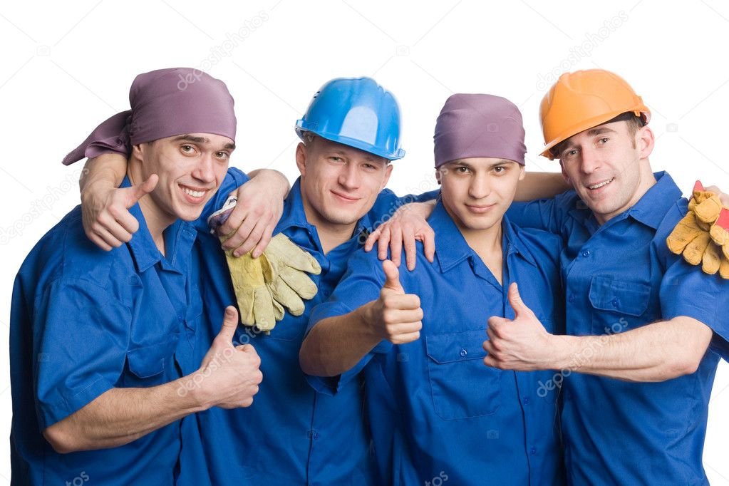 A friendly young team of construction workers shows thumbs sign okay.  — Stock Photo #5776568
