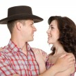Lucky girl and a guy in stetson — Stock Photo