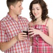 Royalty-Free Stock Photo: Guy treats a girl with a drink