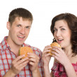 Stock Photo: Girl and a guy eating hamburgers