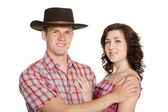Neşeli kız ve adam bir stetson yılında — Stok fotoğraf