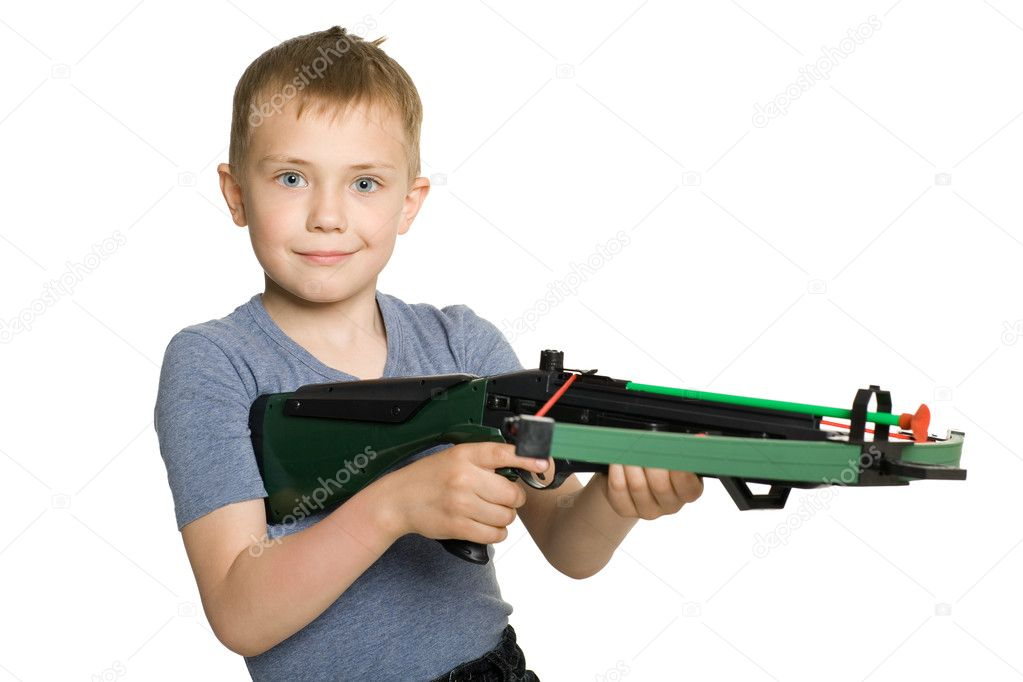 Smiling little boy with the crossbow sport for children. — Stock Photo #5833294