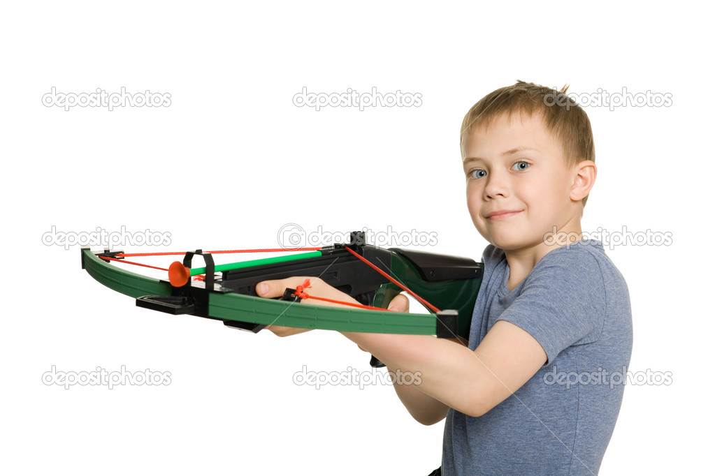 Smiling boy with the crossbow sport for children.  Stock Photo #5833297