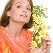 Beautiful woman with yellow roses. — Stock Photo
