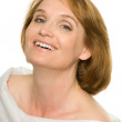 Smiling mature woman in white — Stock Photo #5959673