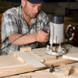Carpenter in the woodworking shop - Stock Photo