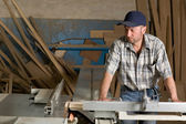 Carpenter working on woodworking machines — Stock Photo