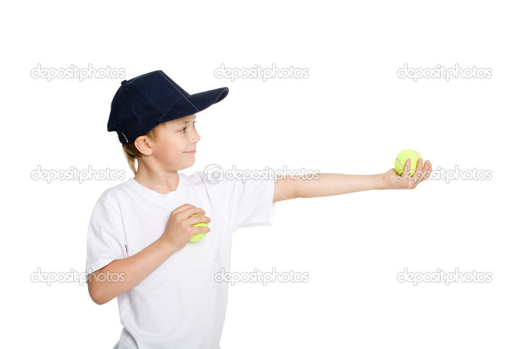 Smiling boy with tennis balls. Isolated on white.  Stock Photo #6134274