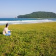 Stock Photo: Mysterious Petrov island and woman