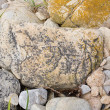 Massive stone carved with hieroglyphics on it. - Stock Photo