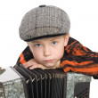 Boy wearing a cap with accordion. — Stock Photo #6395356