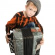 Serious boy with accordion — Stock Photo