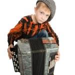 Serious boy with accordion — Stock Photo
