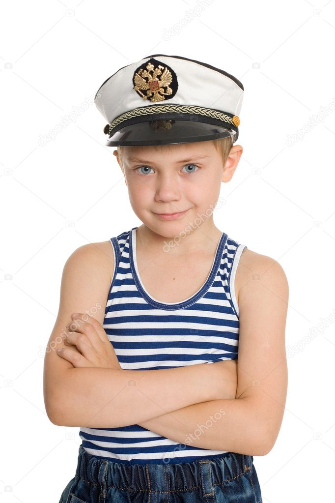 Cute boy in a sea cap. On his cap emblem of Russia.  Stock Photo #6395346
