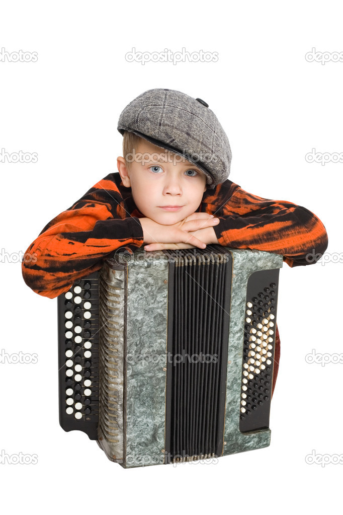Boy wearing a cap with accordion. — Stock Photo #6395355