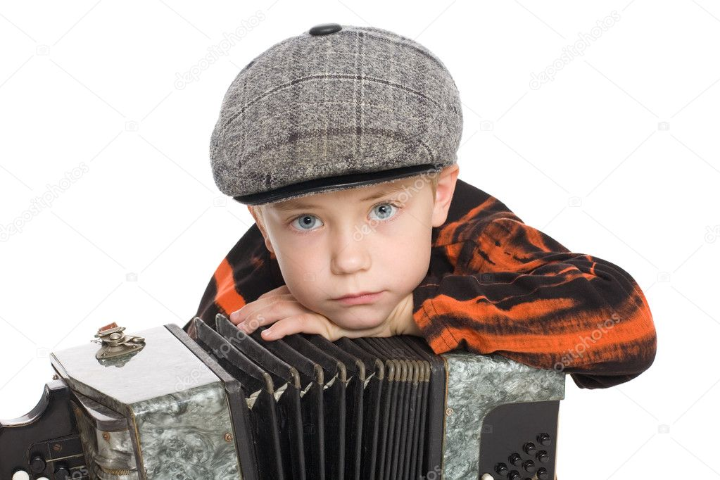 Boy wearing a cap with accordion. Isolated jn white. — Stock Photo #6395356