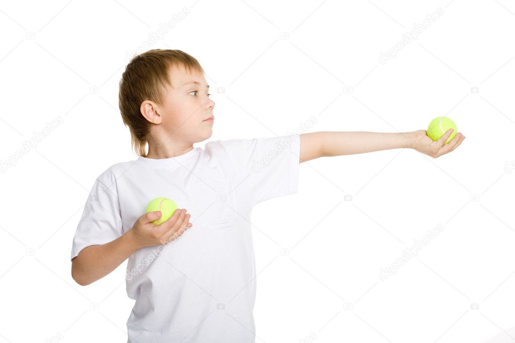 Blond boy holds tennis balls. — Stock Photo #6395377