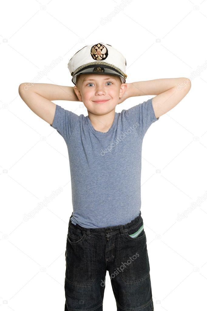 Smiling boy with arms raised. On his cap emblem of Russia.  Stockfoto #6395388