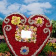Big red heart made of flowers — Stockfoto