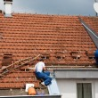 Two men working on the roof — Stock Photo #5856474