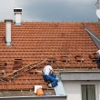 Two men working on the roof — Stock Photo