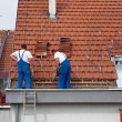 Two men working on the roof — Stock Photo #5859613