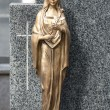 Golden statue of Virgin Mary - Stock Photo