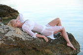 Beautiful blond woman in white lingerie and wet shirt — Stock fotografie