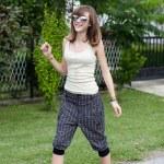 Teenage girl walking on the street — Stock Photo