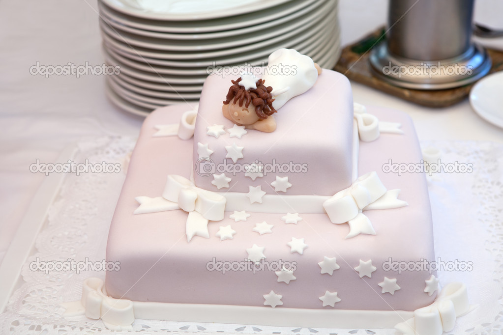 Pink christening cake with little angel on top — Stock Photo #5984081