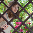 Teenage girl behind a wooden fence — Stock Photo #5990300