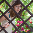 Teenage girl behind a fence — Stock Photo #5990762