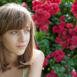 Portrait of a teenage girl in the rose garden — Stock Photo #5995001