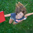 Teenage girl with red laptop — Stockfoto