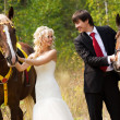 Bride and groom with horses — Stockfoto