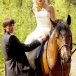Bride and groom with horses — Photo
