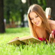 Stock Photo: Woman in the park with book