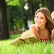 Woman in the park with book - Stock Photo