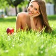 Woman in the park with book — Stock Photo #6259435